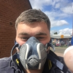 Our Bathroom Fitter with Safety Mask.jpg